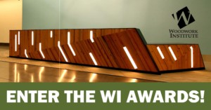 "A wood panelled reception desk, the Woodwork Institute logo, and text: ""Enter the WI Awards!"""