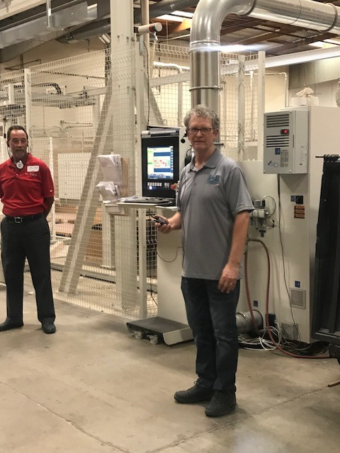 Mike Hansen, during a tour of his millwork ship S&H Cabinets