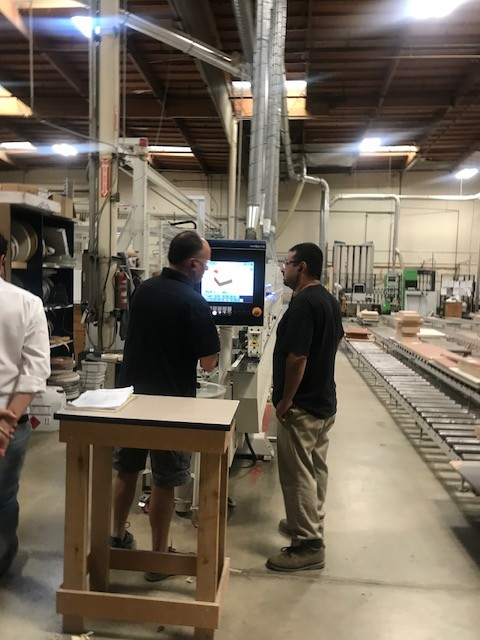 Area meeting attendees touring S&H Cabinets