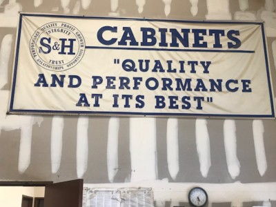 """Sign: """"S&H Cabinets: Quality and Performance at its Best"""""""