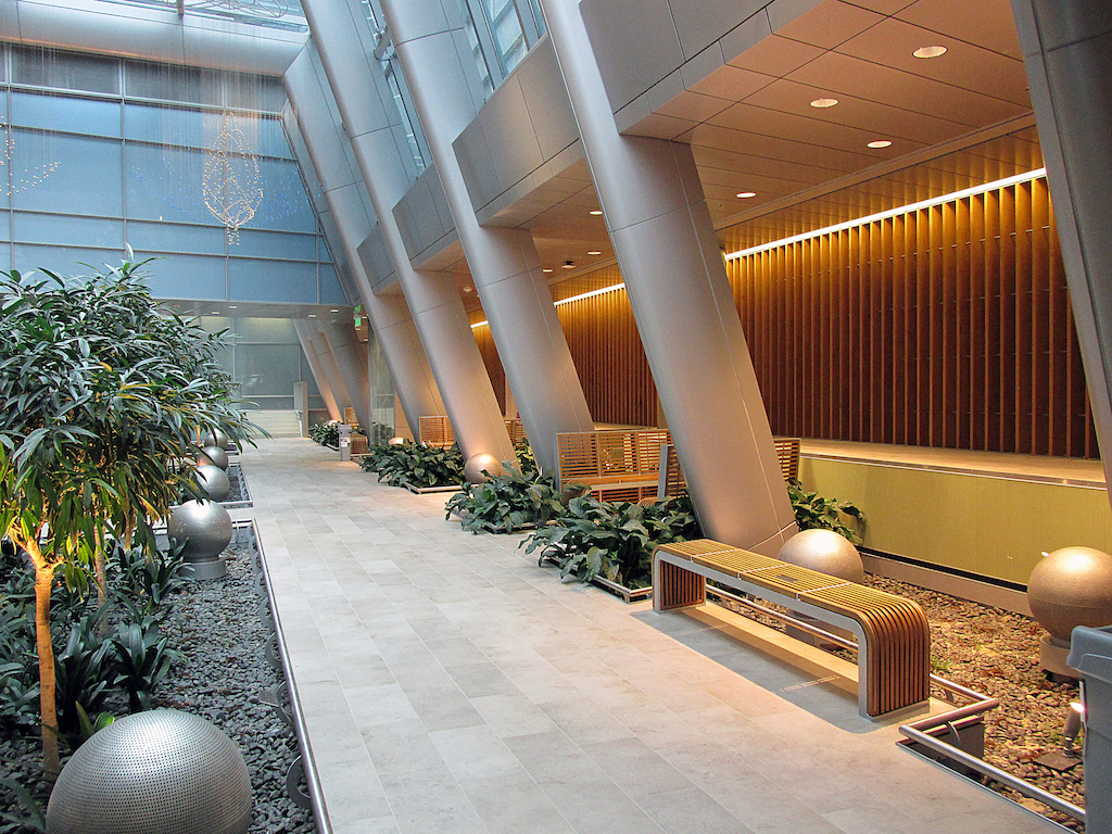 Image of atrium with wood slat wall and benches.
