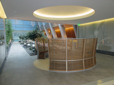 Image of curved wood slat benches and atrium.