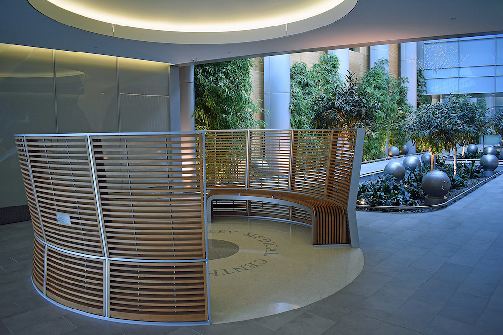 Image of curved wood slat benches.