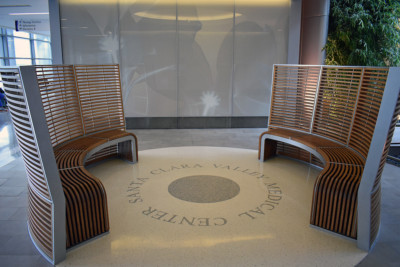 Image of two curved wood slat benches.