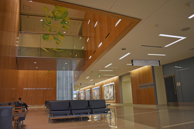 Image of waiting room with wood paneled walls.