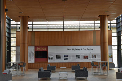 Image of lobby with wood paneled walls, columns and ceiling.