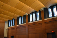 Image of room with wood paneled walls, columns and ceiling.