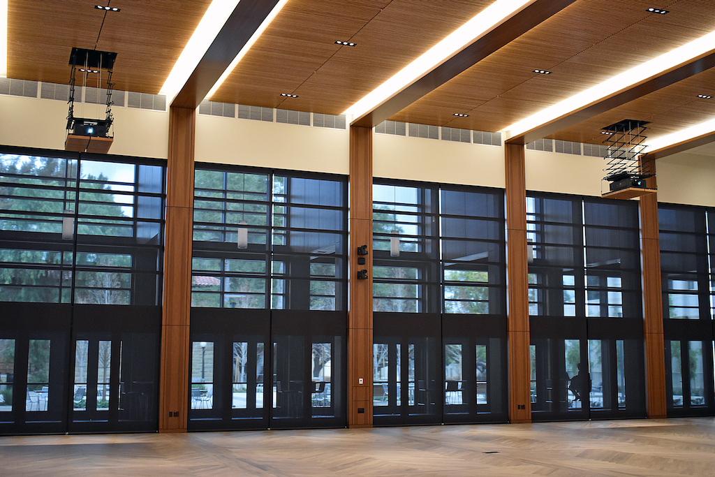 Image of wall of windows with wood paneled columns and ceiling.
